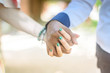 Young couple in love woman and man walking hand in hand, love relationship diversity concept, horizontal