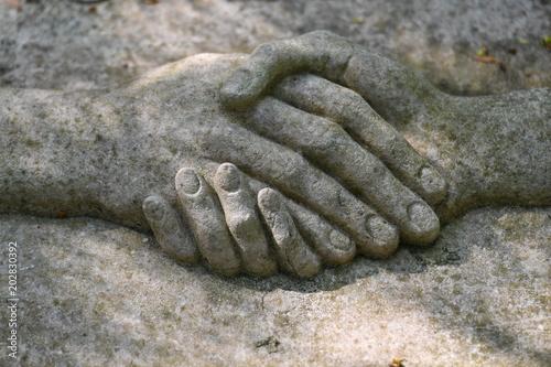 Leinwanddruck Bild Sculpture of a handshake. Donate comfort