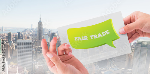 Hand showing card against new york skyline