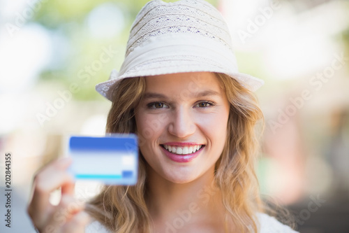 Pretty woman showing a credit card