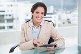 Smiling businesswoman using calculator - 202847799