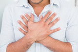 Mid section of man with chest pain - 202850380
