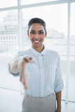 Content smiling businesswoman reaching her hand  - 202853739