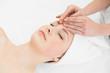 Leinwanddruck Bild - Hands massaging a beautiful womans forehead