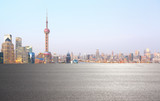 Empty road surface floor with city landmark buildings of Shanghai Skyline