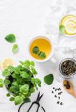Green melissa lemon tea on light background, top view - 202860999