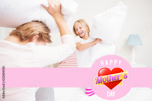 mothers heart against mother and daughter having pillow fight