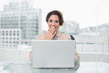 Surprised businesswoman using laptop at her desk - 202893933
