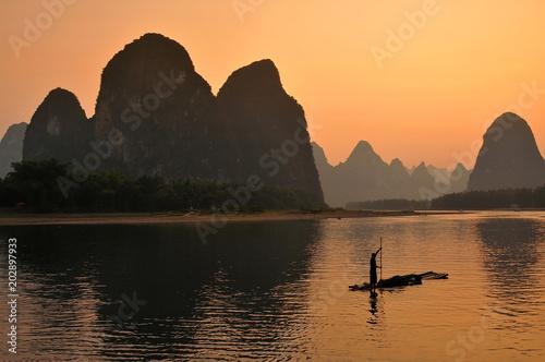 Aluminium Guilin Silhouette of fishermen in Yangshuo, sunset at the LI river. Yangshuo is a popular tourist county and city near Guilin Guangxi China.