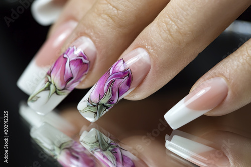 Plexiglas Manicure Beautiful multicolored flowers on a transparent lacquer on the nails