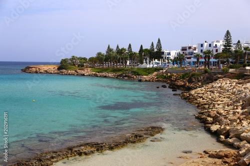 Plexiglas Cyprus Blue beach umbrellas and sunbeds on Sandy Beach in Ayia Napa, Cyprus