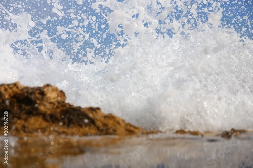 Foto Spatwand Cathedral Cove wave and splashes on beach of cathedrals in ribadeo