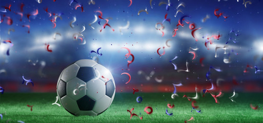Football ball on the field of a world cup stadium with streamers - 3d rendering