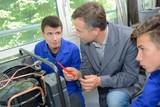 Mechanic students with their teacher - 202921755