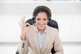 Happy businesswoman showing okay sign - 202925502