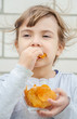 child eats chips. selective focus.