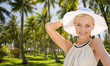 Quadro travel, tourism and summer vacation concept - beautiful woman in hat enjoying sun over palm trees background in french polynesia