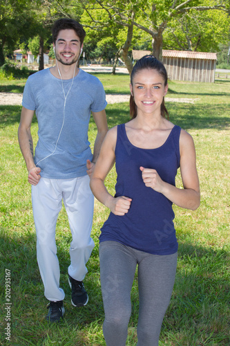 young health couple jogging in the park