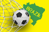 Football at back of net against green brazil outline on yellow with text - 202958162