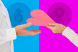 Woman handing man a paper heart against pink and blue