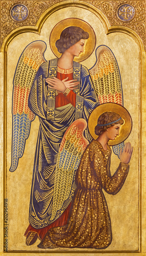 ZARAGOZA, SPAIN - MARCH 1, 2018:  The icon of prayered angels on the main altar in church Iglesia del Perpetuo Socorro by pater Jesus Faus (1953 - 1959). © Renáta Sedmáková