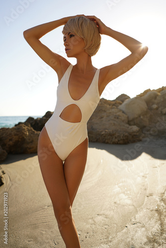 Canvas Women Art Graceful woman in white swimwear on the beach
