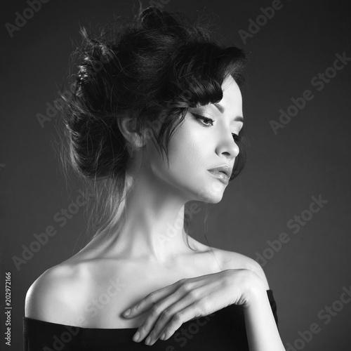 Plexiglas Women Art Beautiful woman with elegant hairstyle on black background