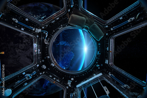 Foto Murales View from a porthole of space station on the Earth background. Elements of this image furnished by NASA.