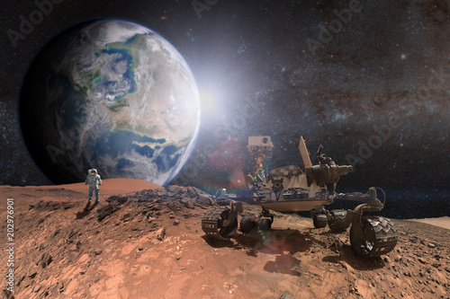 Curiosity Mars Rover exploring the surface of red planet. Elements of this image furnished by NASA. - 202976901