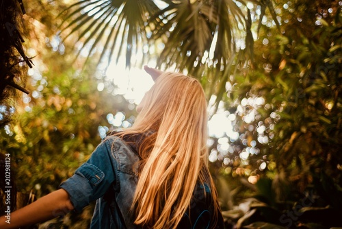 Girl tourist walking in the tropical forest - 202981124