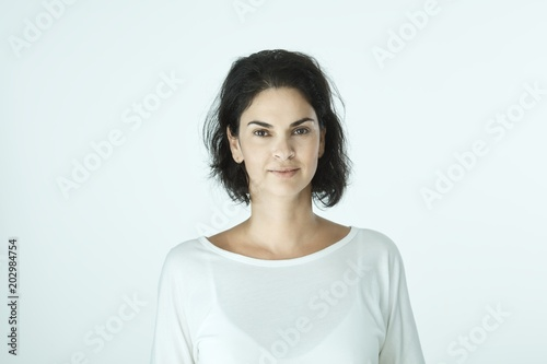 Portrait of casual smiling woman on white