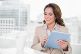 Beautiful happy businesswoman using tablet - 202998301