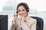 Content businesswoman touching headset - 203027351