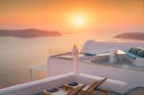 Beautiful and famous sunset on Santorini island, Greece - 203039382