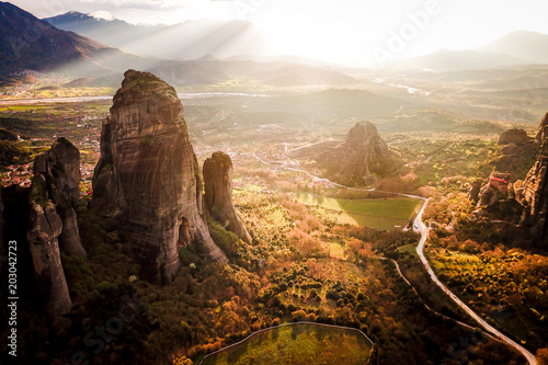 Fotobehang Zwart Sunset over Meteora