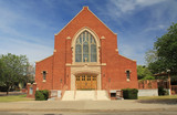 Red brick exterior of Grace Evangelical Lutheran Church in Tucson, Arizona with blue sky copy space,  stained glass windows. - 203044765