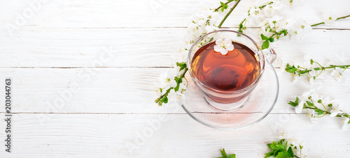 Fototapeta Herb tea with flowers. On a wooden background. Top view. Copy space.