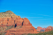 The red rocks of Sedona with plenty of blue sky that can be used as copy space.