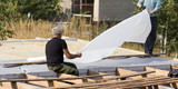 Workers cut the roof in the house - 203108336