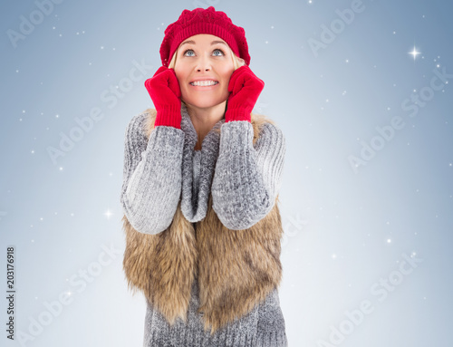 Blonde in winter clothes smiling on vignette background