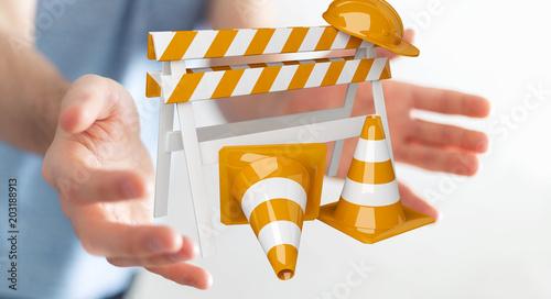 Businessman using digital 3D rendering under construction signs - 203188913