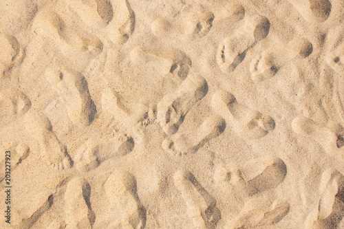 Fototapeta Many footprints on sand.