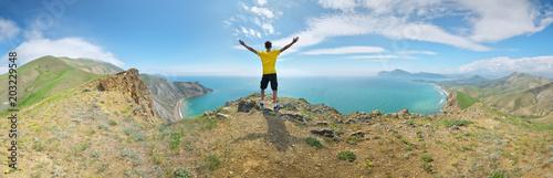 Man and mountain sea landscape panorama.