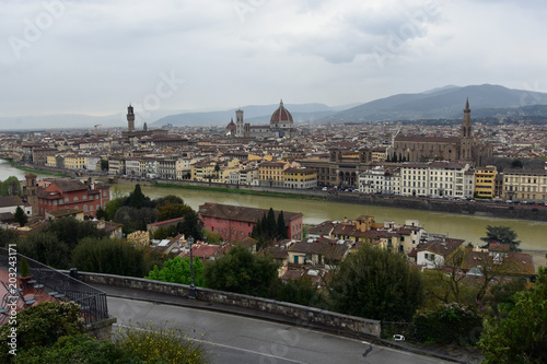 Fototapeta View from Piazzale Michelangelo, Florence, Italy down to the historic town of Florence and Arno River in a rainy day