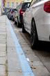 Leinwandbild Motiv blue zone and parked cars