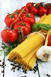 Italian food background with pasta, basil and tomato, health or vegetarian concept. - 203253305
