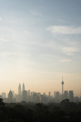 vertical or potrait image of Beautiful Kuala Lumpur cityscape skyline in the morning environment and the buildings in silhouette. tourism and development concept
