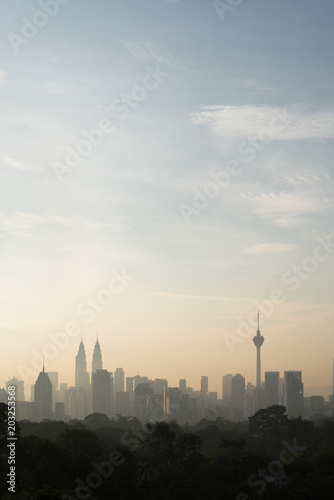 Fotobehang Kuala Lumpur vertical or potrait image of Beautiful Kuala Lumpur cityscape skyline in the morning environment and the buildings in silhouette. tourism and development concept