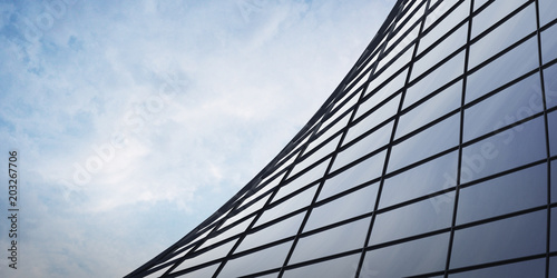 View of the clouds reflected in the curve glass office building. 3d rendering - 203267706