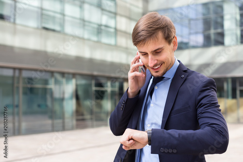 Foto Murales Businessman talking on the phone  outside